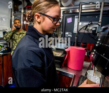 180122-N-NG136-091 NORFOLK, Va (Jan. 22, 2018) Aviation Ordnanceman Airman Sarah Boone operates an espresso machine aboard the aircraft carrier USS George H.W. Bush (CVN 77). The ship is in port in Norfolk, Virginia, conducting routine maintenance in preparation for the Board of Inspection and Survey (INSURV). (U.S. Navy photo by Mass Communication Specialist 3rd Class Zachary P. Wickline/Released) - Stock Photo