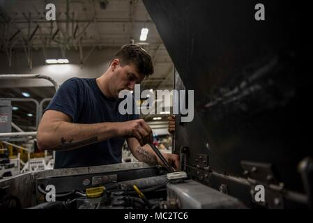 180122-N-AJ467-039 NORFOLK, Va (Jan. 22, 2018) Aviation Support Equipment Technician 3rd Class Trent Davis performs maintenance on a tractor aboard the aircraft carrier USS George H.W. Bush (CVN 77). The ship is in port in Norfolk, Virginia, conducting routine maintenance in preparation for the Board of Inspection and Survey (INSURV). (U.S. Navy photo by Mass Communication Specialist 3rd Class Darien Weigel/Released) - Stock Photo