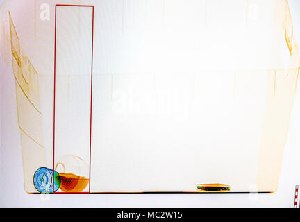 X-ray screenshot of a bag with, from left to right : a spray bottle, a bottle of water and a smartphone. - Stock Photo