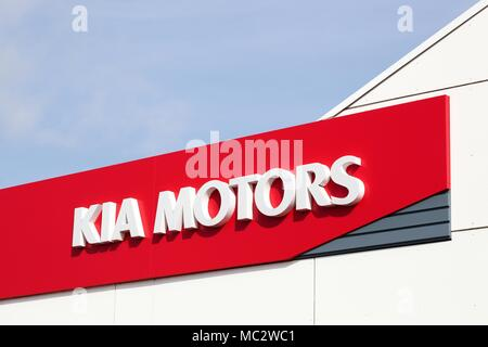 Horsens, Denmark - April 1, 2018: Kia Motors logo on a wall of a dealership. Kia Motors Corporation headquartered in Seoul - Stock Photo