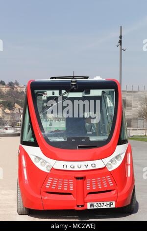 Lyon, France - March 15, 2017: Navya autonomous vehicule in Lyon. Navya is a French company specialized in the construction of autonomous vehicles - Stock Photo