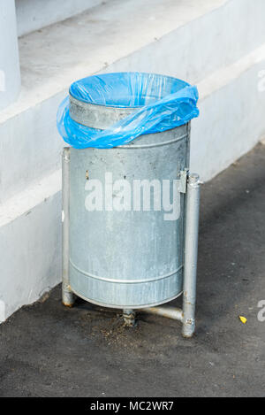 street metal trash with a package - Stock Photo