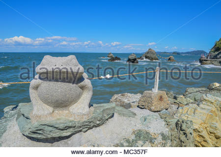 Frog Statue In Front Of Meoto Iwa (Wedded Rocks) Japan - Stock Photo
