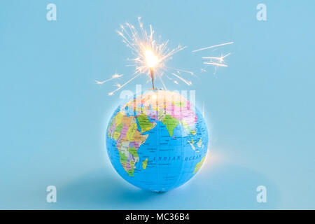 Globe grenade isolated on blue minimal creative concept - Stock Photo