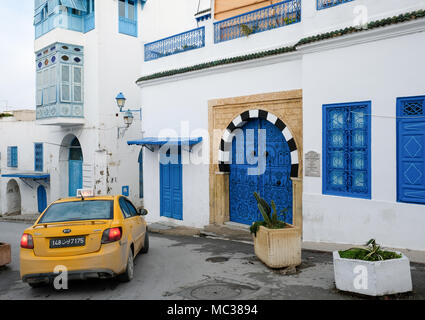 A taxi in Sidi Bou Said, in Tunesia. The city is painted in white and blue for the most part - Stock Photo