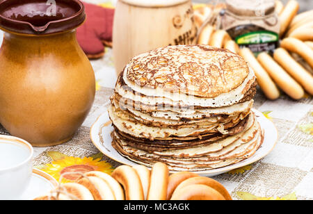 Stack of tasty fried pancakes and bagels on the table - Stock Photo