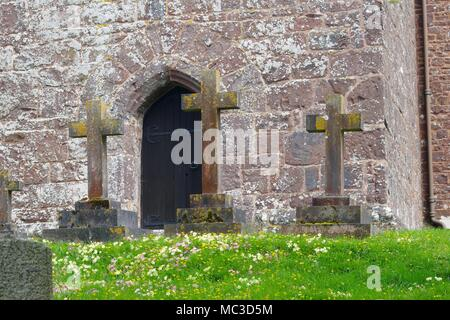 Three Headstone Crucifixes by St Mary The Virgin Church in Bickleigh on Easter. Tiverton, Devon, UK. - Stock Photo