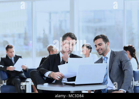 business partners discuss financial issues sitting in the lobby of the Bank. photo with copy space. - Stock Photo