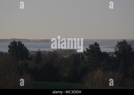 Looking South Down the Exe Estuary at High Tide, towards Exmouth and Dawlish Warren. From Ludwell Valley Park, Exeter, Devon, UK. - Stock Photo