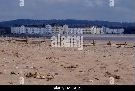 Exmouth Seafront Seen From Dawlish Warren Sand Spit, Wooden Beach Groyne in Foreground. South Devon, UK. April, 2018. - Stock Photo