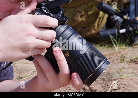 Entomologist doing Macro Nature Photography, with Nikon DSLR and Sigma Lens. Dawlish Warren, Devon, UK. Spring, 2018. - Stock Photo