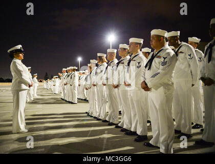 """SAN DIEGO (Mar. 16, 2018)  Sailors from Naval Medical Center San Diego""""s (NMCSD) Directorate for Administration (DFA) stand in formation during a dress whites inspection. DFA is committed to providing quality, timely, innovative and economical healthcare administration to staff and patients of NMCSD. - Stock Photo"""