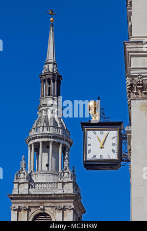 City of London.  An Atlas clock on the corner of Ironmonger Lane and Cheapside, with St Mary-le-Bow in the background - Stock Photo