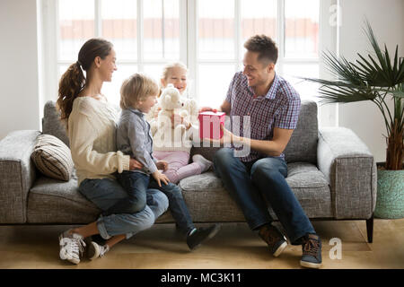 Receiving present on fathers day concept, family kids congratula - Stock Photo