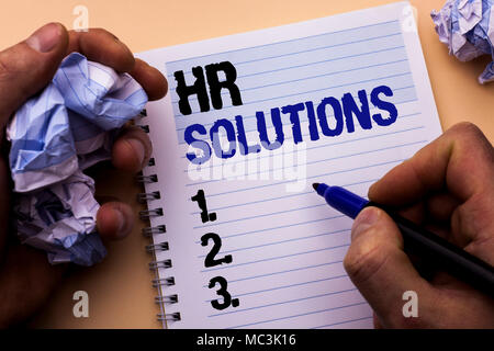 Handwriting text Hr Solutions. Concept meaning Recruitment Solution Consulting Management Solving Onboarding written by Man Notebook Book Holding Mark - Stock Photo