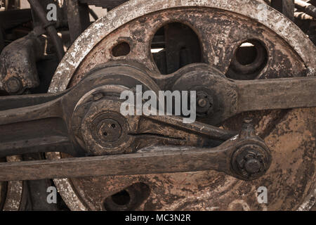 Closeup view of wheels of abandoned old rusty soviet locomotive at platform. Horizontal color photography. - Stock Photo