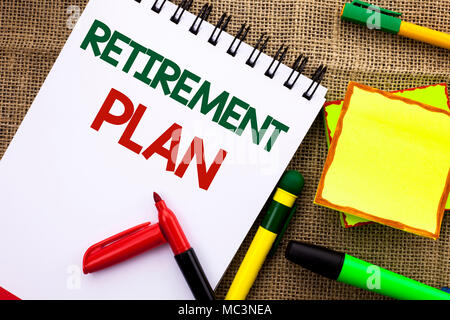 Writing note showing  Retirement Plan. Business photo showcasing Savings Investments that provide incomes for retired workers written Notebook Book th - Stock Photo