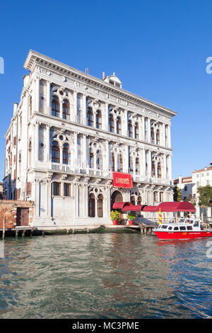 Casino di Venezia, Cannaregio, Grand Canal, Venice, Italy, listed as the oldest casino dating from 1638  in Ca' Vendramin Calergi with their red boat  - Stock Photo