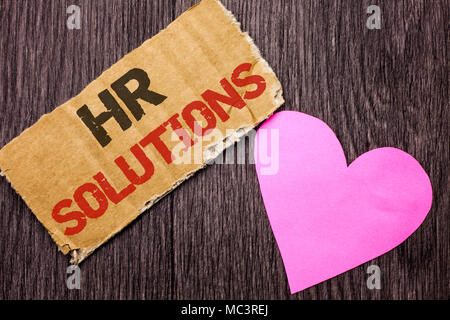 Handwriting text Hr Solutions. Concept meaning Recruitment Solution Consulting Management Solving Onboarding written Cardboard Piece the wooden backgr - Stock Photo