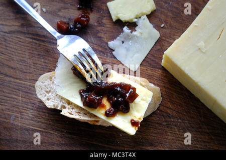 Cheese and pickle on rustic bread - Stock Photo