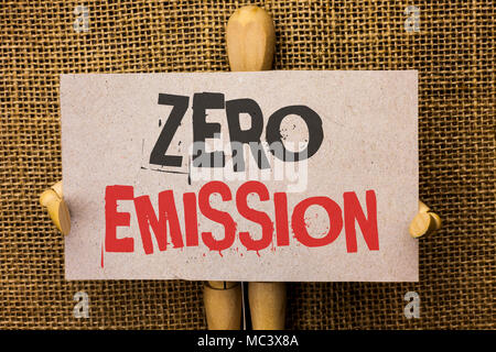 Conceptual hand writing showing Zero Emission. Business photo text Engine Motor Energy Source that emits no waste products written on Cardboard Piece on the jute background Love Hearts. - Stock Photo