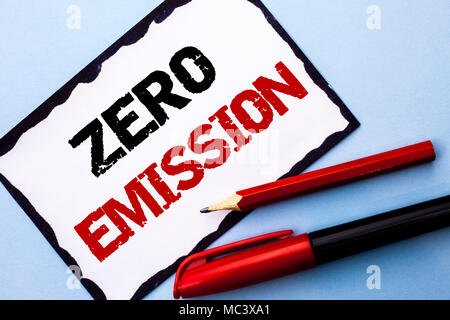 Conceptual hand writing showing Zero Emission. Business photo text Engine Motor Energy Source that emits no waste products written on White Sticky Note Paper on the Blue background Pen Pencil - Stock Photo