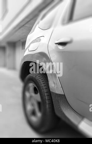 Dents on the car caused by the accident. Defocused blurry background. - Stock Photo