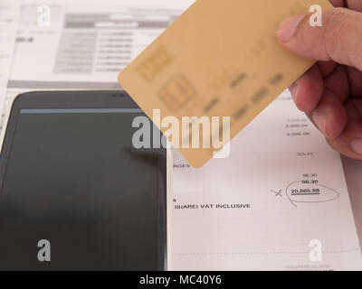 Blur, invoicing, bill payment., Phone and credit card - Stock Photo