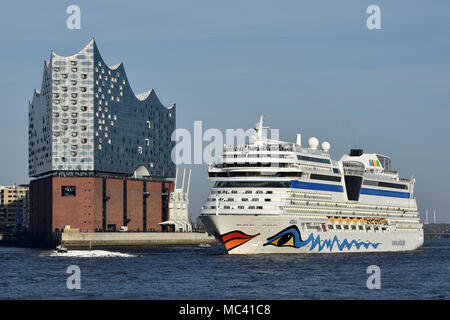 AIDAsol outbound from Hamburg passing the Elbphilharmonie concert hall - Stock Photo