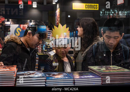 April 12, 2018 - Barcelona, Catalonia, Spain - Several children seen watching comics books. Opening of the 36th Barcelona International Comic Fair from 12th-15th April 2018 in Fira Barcelona Montjuïc. (Credit Image: © Paco Freire/SOPA Images via ZUMA Wire) - Stock Photo