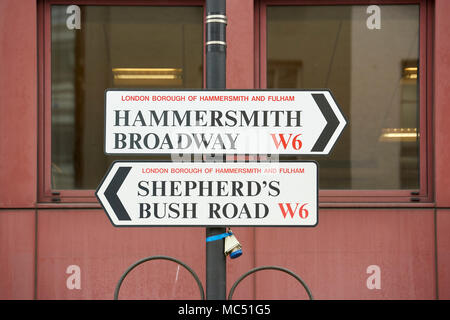 Street sign with directions to Hammersmith and Shepherds Bush, both located within the London Borough of Hammersmith and Fulham. - Stock Photo