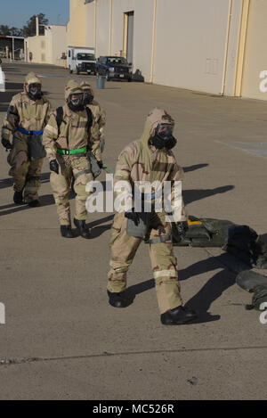 Several Airmen conduct a sweep for potential hazards after a simulated missile attack during a readiness exercise at Travis Air Force Base, Calif., Jan. 31, 2018. The exercise tested the base's emergency response capabilities. (U.S. Air Force photo/Tech. Sgt. James Hodgman) - Stock Photo