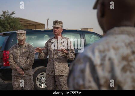 UNDISCLOSED LOCATION, Middle East –  Lt. Gen. William D. Beydler (middle), commander, Marine Corps Forces Central Command and Lt. Gen. Michael A. Rocco , deputy commandant, Manpower and Reserve Affairs, speak to members of Marine Wing Support Squadron 373, Special Purpose Marine Air-Ground – Task Force – Crisis Response – Central Command, Jan. 26, 2018. Marine Corps Forces Central Command leadership visited SPMAGTF-CR-CC as part of a larger tour of Marine Corps Forces Central Command's area of responsibility. - Stock Photo