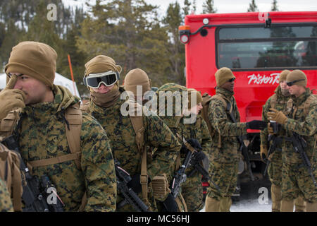 Marines with 2nd Marine Logistics Group gather for a hike at Marine Corps Mountain Warfare Training Center, Bridgeport, Calif., Jan. 23, 2018. The Marines, from Combat Logistics Regiment 25 and 2nd Transportation Support Battalion, took part in cold weather training designed to provide the Marines experience in climbing, military mountaineering, snow mobility, field craft, and survival. (U.S. Marine Corps photo by Cpl. Sean M. Evans) - Stock Photo