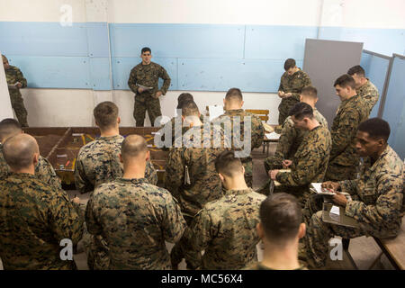 U.S. Marines with Black Sea Rotational Force 17.2 and Greek Marines with 32nd Marine Brigade use a terrain model to plan for a force-on-force attack in Volos, Greece Jan. 16, 2018. During the exercise Alpha and Bravo companies will conduct combined company-level tactical operations to seize the battalion objective. - Stock Photo