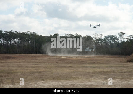 Two V-22 Osprey aircraft assigned to Marine Medium Tiltrotor Squadron 261 (VMM-261) prepare to land during a TRAP mission on Stone Bay, N.C., January 31, 2018.  The purpose of a Tactical Recovery of Aircraft and Personnel (TRAP) is to recover equipment, personnel, repair equipment, or destroy equipment left behind from a down aircraft or ground vehicle. (U.S. Marine Corps photo by LCpl. Angel D. Travis) - Stock Photo