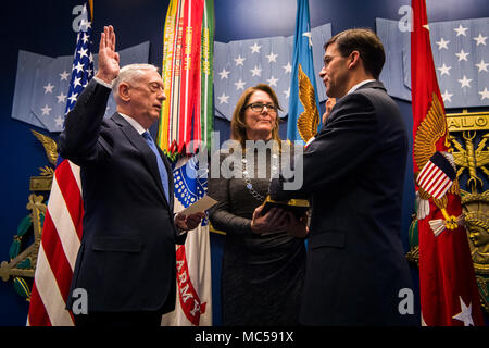 Secretary of Defense James N. Mattis officially welcomed back Army Secretary Dr. Mark T. Esper into the service that raised him during a swearing-in ceremony held in the Pentagon Friday, Jan. 5, 2018. - Stock Photo