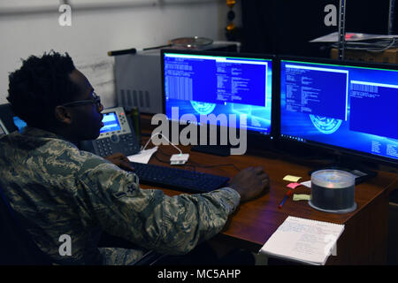 U.S. Air Force Airman Justin Wilson, 39th Communications Squadron client systems technician, runs a program called PowerShell that gathers network information from specific devices and ensures that everything is working correctly at Incirlik Air Base, Turkey, Jan. 16, 2018. Client systems technicians add computers to the domain, by ensuring the machines are pulling correct IP addresses and they are connecting to the correct domain, by checking these settings in the program PowerShell. (U.S. Air Force photo by Staff. Sgt. Jason Huddleston) - Stock Photo