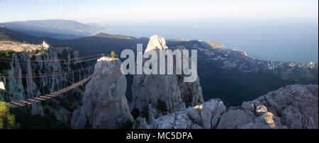 The cable car on the top of the Ai-Petri mountain peninsula of Crimea and a magnificent view of the city. Landscape. - Stock Photo