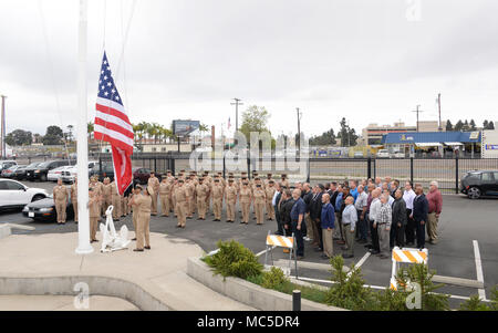 180402-N-UN340-002 SAN DIEGO (Apr. 2, 2018) Active duty and retried Chief Petty Officers assigned to Space and Naval Warfare Systems Command (SPAWAR) are joined by the SPAWAR wardroom in observance of morning colors to celebrate the 125th birthday of the Chief Petty Officer rank.   (U.S. Navy photo by Rick Naystatt/Released) - Stock Photo
