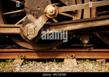 Close-up, detail, drive mechanism on wheel of vintage steam engine, train, locomotive, abstract, object - Stock Photo