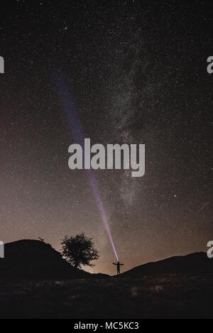 The Milky Way and beautiful night sky full of stars in background - Stock Photo