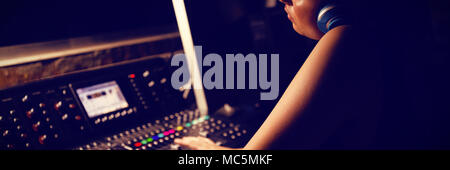 Audio engineer using sound recording equipment - Stock Photo