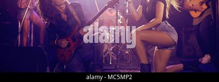 Musicians on stage at nightclub - Stock Photo