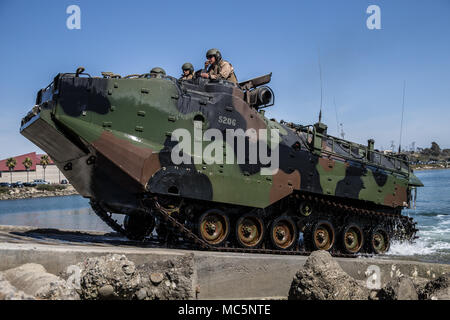 U.S. Marines with the Assault Amphibian School, recover an AAV-P7/A1 on Camp Pendleton, Calif., April 9, 2018. During the training, Class 6-18 learned how to drive and operate an AAV-P7/A1, and how to recover the vehicle after amphibious operations. (U.S. Marine Corps photo by Lance Cpl. Dalton Swanbeck) - Stock Photo