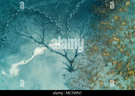 Abstract natural icy background. Frozen lake. Patterns on the surface of a frozen lake - Stock Photo