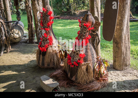 Two ancestral figures inside an anciente Haus tambaran, Kanganaman Village, East Sepik Province, Papua New Guinea - Stock Photo