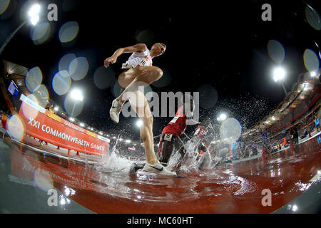 Canada's Matthew Hughes (left) and Kenya's Abraham Kibiwott (right) in action in the Men's 3000m Steeplechase Final at the Carrara Stadium during day nine of the 2018 Commonwealth Games in the Gold Coast, Australia. - Stock Photo