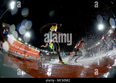 Uganda's Albert Chemutai in action in the Men's 3000m Steeplechase Final at the Carrara Stadium during day nine of the 2018 Commonwealth Games in the Gold Coast, Australia. - Stock Photo