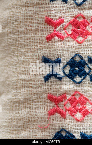 Embroidered pattern on cotton fabric .   Fragment. Handmade. - Stock Photo